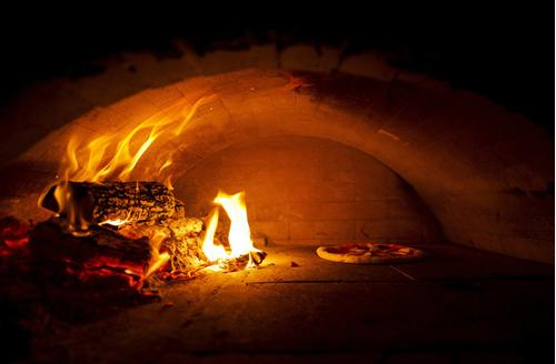 Wood oven pizza burning