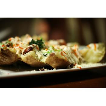 Picture of baked potato richly stuffed with cheese